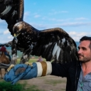Fulbright recipient Jake Kennedy with eagle in Mongolia