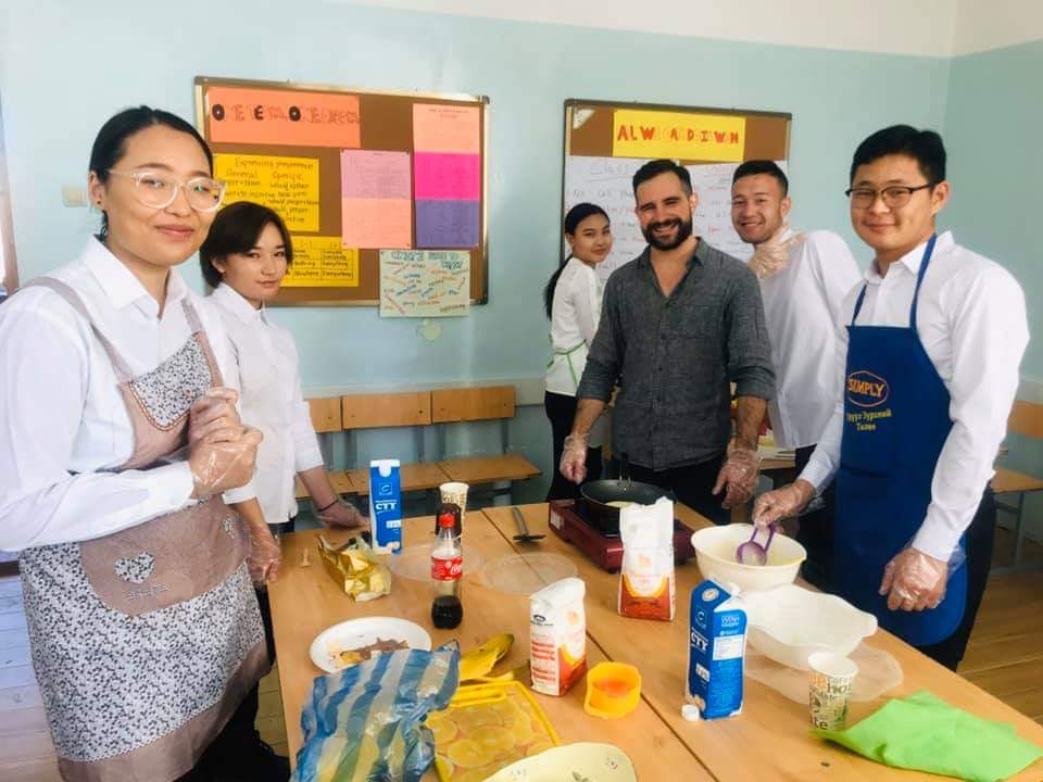 My students and I cooking banana pancakes for our international food day. USA food competed with Chinese, Korean, and Russian food. We cooked many other dishes, too